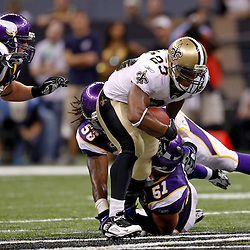 September 9, 2010; New Orleans, LA, USA;  New Orleans Saints running back Pierre Thomas (23) breaks tackles by Minnesota Vikings linebacker E.J. Henderson (56) and linebacker Ben Leber (51) in the fourth quarter to get a first down securing a 14-9 win during the NFL Kickoff season opener at the Louisiana Superdome.   Mandatory Credit: Derick E. Hingle