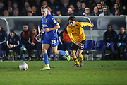 AFC Wimbledon midfielder Max Sanders (23) dribbling past Southend United midfielder Isaac Hutchinson (36) during the EFL Sky Bet League 1 match between AFC Wimbledon and Southend United at the Cherry Red Records Stadium, Kingston, England on 1 January 2020.
