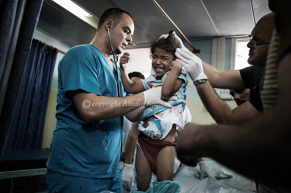 Gaza Strip, Gaza City: A young Palestinian girl is examined at Al Shifa hospital in Gaza City as she suffered injuries by Israeli shelling. ALESSIO ROMENZI