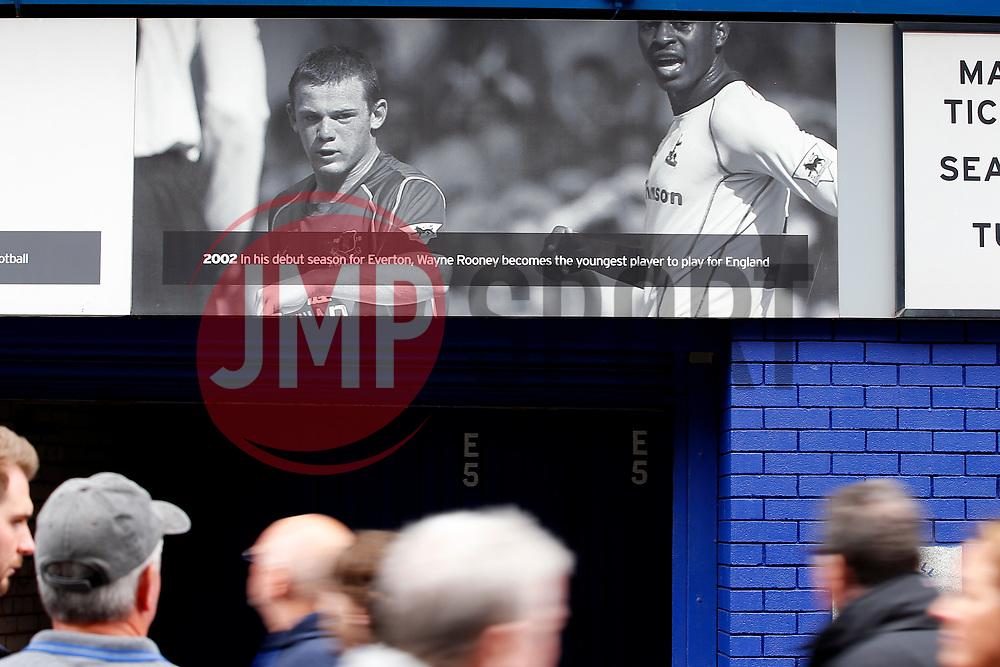 Everton fans walk past a Wayne Rooney plaque on the wall of Goodison Park - Mandatory by-line: Matt McNulty/JMP - 06/08/2017 - FOOTBALL - Goodison Park - Liverpool, England - Everton v Sevilla - Pre-season friendly