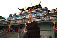 Rinchen Khandro, a Buddhist nun from the Samye Ling community in southern Scotland, pictured in front of the monastery's temple on her final day before travelling to Holy Island off the west coast where the former model, songwriter and fashion designer will spend the next three years.