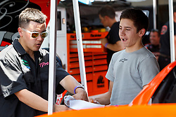 BAKERSFIELD, CA - MAY 24:  James Bickford driver of the #6 Sunrise Ford/Lucas Oil/Eibach Ford talks to Luis Tyrrell driver of the #74 Rodan Builders Chevrolet in the garage during practice before the NASCAR K&N Pro Series West Armed Forces 150 at the Kern County Raceway Park on May 24, 2014 in Bakersfield, California. (Photo by Jason O. Watson/Getty Images for NASCAR) *** Local Caption *** James Bickford; Luis Tyrrell