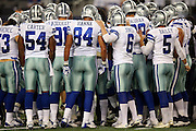 The Dallas Cowboys huddle in a group before the NFL week 8 regular season football game against the Washington Redskins on Monday, Oct. 27, 2014 Arlington, Texas. The Redskins won the game 20-17 in overtime. ©Paul Anthony Spinelli