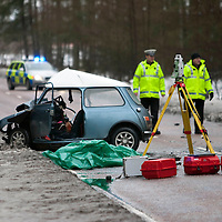 12.01.10.....Fatal Road Traffic Crash on the A93 Perth Road, five miles south of Blairgowrie near Meiklour. The driver of the mini a 17 year old man was pronounced dead at the scene the passenger in the mini was cut free and taken to Ninewells Hospital, Dundee. The 50 year old driver of the other vehicle involved a Ford Fiesta van was also taken to Ninewells Hospital.<br /> Picture by Graeme Hart.<br /> Copyright Perthshire Picture Agency<br /> Tel: 01738 623350  Mobile: 07990 594431