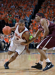 Virginia Cavaliers guard J.R. Reynolds (2) dribbles around Virginia Tech Hokies Markus Sailes (24).  The Virginia Cavaliers Men's Basketball Team defeated the Virginia Tech Hokies 69-56 at the John Paul Jones Arena in Charlottesville, VA on March 1, 2007.