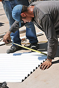 Measuring a fence panel.