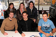 The Dayton Gems sit for photos with fans and sign autographs at Brixx Ice Company, Tuesday, January 19, 2010.
