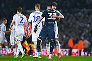 Liam Cooper of Leeds United (6) his Francisco Casilla of Leeds United (33) after winning 4-0 during the EFL Sky Bet Championship match between Leeds United and West Bromwich Albion at Elland Road, Leeds, England on 1 March 2019.