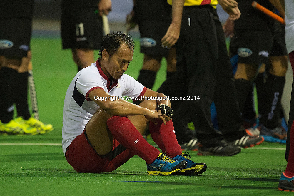 Koji Kayukawa of Japan sits dejected after their loss during the Black Sticks Men v Japan international hockey match at the Coastlands Kapiti Sports Turf in Paraparaumu on Friday the 21st of November 2014. Photo by Marty Melville/www.Photosport.co.nz
