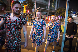 © Licensed to London News Pictures . 01/11/2015 . Manchester , UK . Men wearing floral dresses . Halloween revellers , wearing make up and costumes , out and about in Manchester City Centre . Photo credit : Joel Goodman/LNP