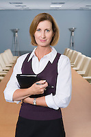 Businesswoman Standing in Meeting Room Portrait
