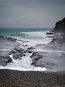 Waves pound the coast at Curio Bay, south end of South Island, New Zealand