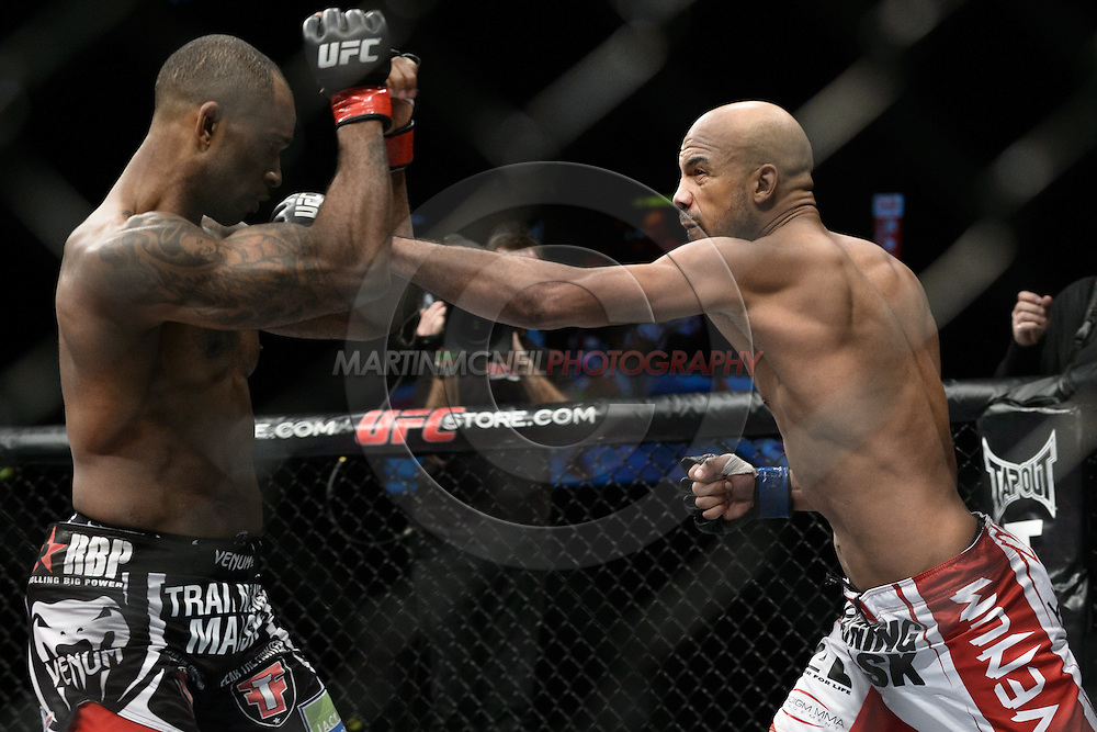 "LONDON, ENGLAND, FEBRUARY 16, 2013: Jimi Manuwa (L) tries to block a straight left from Cyrille Diabate during ""UFC on Fuel TV 7: Barao vs. McDonald"" inside Wembley Arena in Wembley, London on Saturday, February 16, 2013 (© Martin McNeil)"