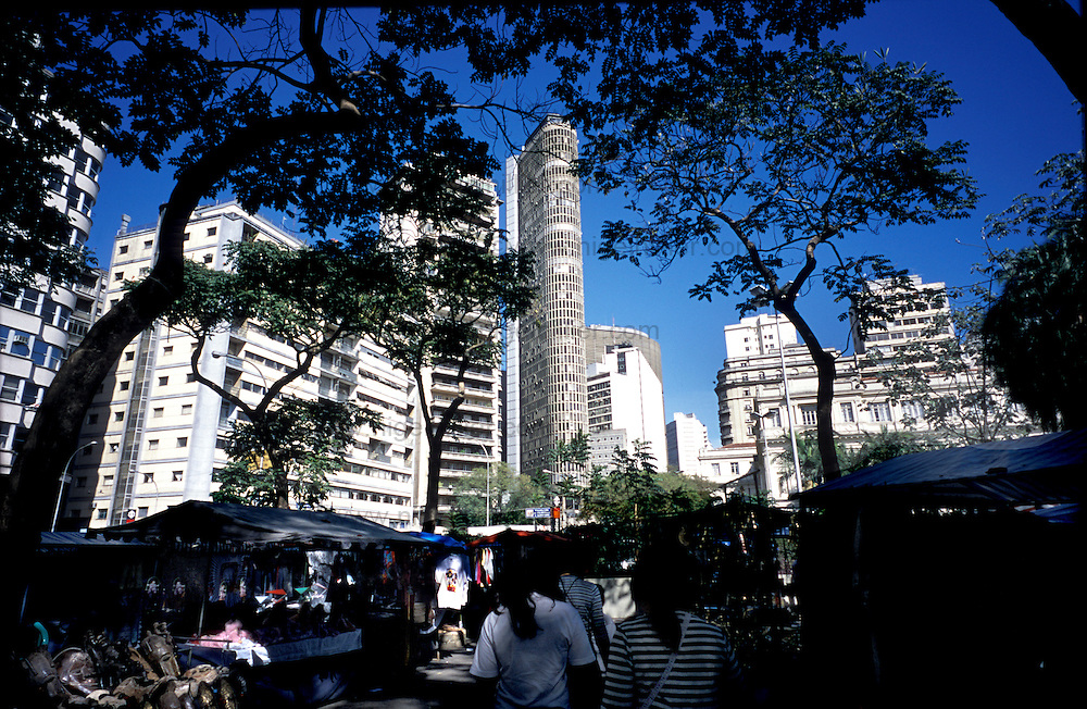 Brazil,Sao Paolo,Praca De Republica. market in shadow, buildings in sun shine