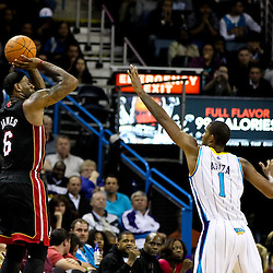 November 5, 2010; New Orleans, LA, USA;  Miami Heat small forward LeBron James (6) shoots over New Orleans Hornets small forward Trevor Ariza (1) during a game at the New Orleans Arena. The Hornets defeated the Heat 96-93. Mandatory Credit: Derick E. Hingle