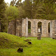 "Ruins of church in the destroyed village of Ornes, located in the ""zone rouge"" (red zone) near Verdun, the name given to about 1,200 square kilometres (460 sq mi) of land in northeastern France that was physically and environmentally destroyed during the First World War."