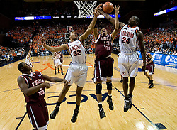 Virginia forward Mike Scott (32) and guard/forward Mamadi Diane (24) battles with Virginia Tech forward Deron Washington (13) for a rebound.  The Virginia Cavaliers men's basketball team fell to the Virginia Tech Hokies 70-69 in overtime at the John Paul Jones Arena in Charlottesville, VA on January 16, 2008.