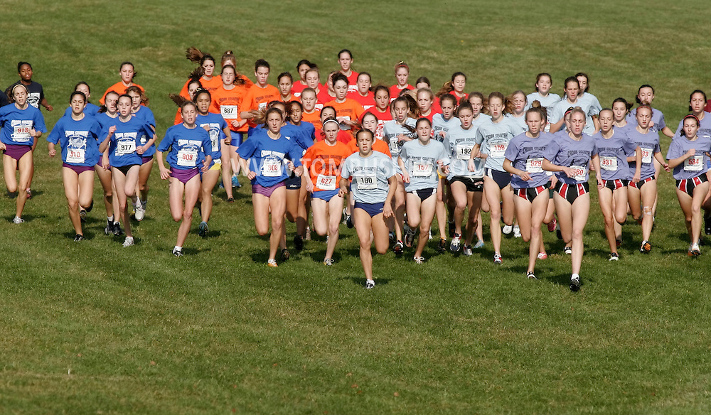 Warwick, N.Y. - Runners take off at the start of the girls' Class AA race at the New York State Public High School Athletic Association cross country championships at Sanfordville Elementary School on Nov. 11, 2006.<br />
