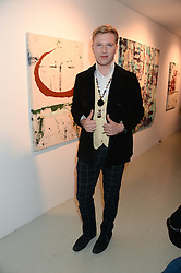 HENRY CONWAY at a private view of an exhibition of paintings by Billy Zane entitled 'Save The Day Bed' held at the Rook & Raven Gallery, Rathbone Place, London on 10th October 2013.