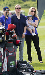 Autumn Phillips hold her niece - Mike Tindall and Zara's daughter Mia., whilst Zara looks on, at a  celebrity golf event  in aid of Rugby for Heroes at Celtic Manor,Wales, United Kingdom, Monday, 19th May 2014. Picture by  i-Images