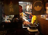 People eating in a restaurant in Omoide-yokocho, an alley of small eateries serving yakatori in Shinjuku, Tokyo, Honshu, Japan