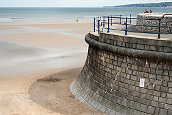 Part of the sea defenses on Filey Beach and Filey Bay looking towards Flambrough Head from Royal Parade Filey