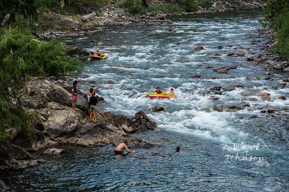 Family rafting down the Cle Elum River, Okanogan-Wenatchee National Forest, Washington, USA