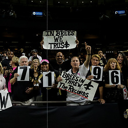 Oct 8, 2018; New Orleans, LA, USA New Orleans Saints fans celebrate quarterback Drew Brees (not pictured) breaking the NFL passing yardage record against the Washington Redskins at the Mercedes-Benz Superdome. The Saints defeated the Redskins 43-19.