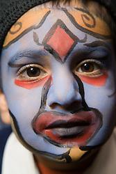 Boy with a painted face at the Nottingham Islamia school Eid Fair,