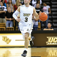 A.J. Rompza (3) of the University of Central Florida Knights mens basketball team drives the ball against the West Florida Argonauts in the first home game of the 2010 season at the UCF Arena on November 12, 2010 in Orlando, Florida. UCF won the game 115-61. (AP Photo/Alex Menendez)