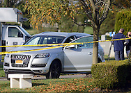 Police personnel investigate the scene of a shooting Wednesday October 26, 2016 at Roosevelt Memorial Park in Bensalem, Pennsylvania. (Photo by William Thomas Cain)