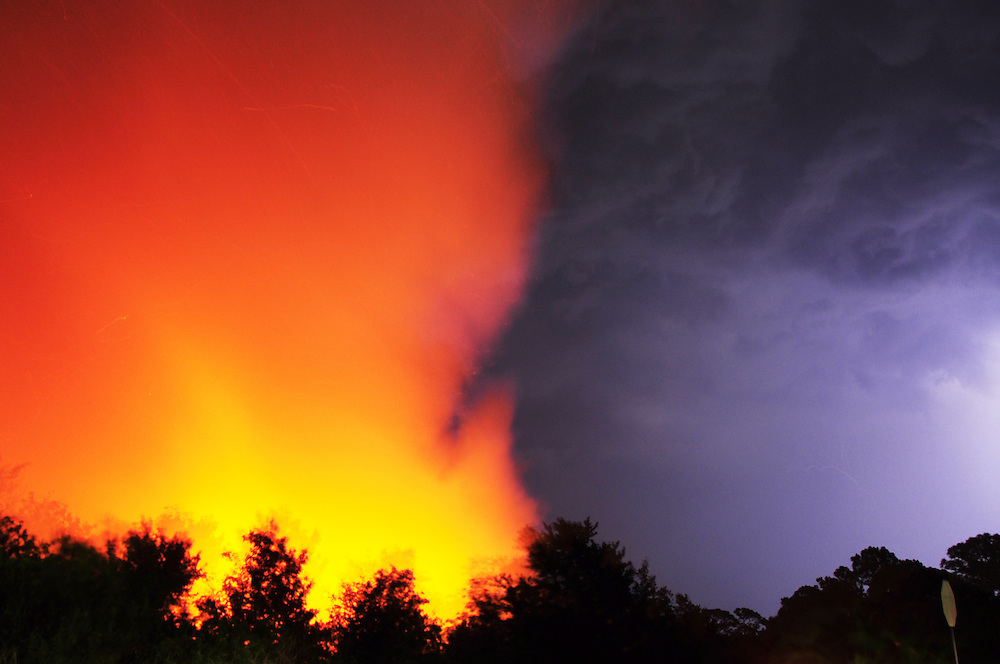 Andrew Knapp, FLORIDA TODAY -- June 14, 2011 -- Lightning flashes near a wildfire sparked Tuesday evening by lightning just west of the Devereux Florida facility at Murrell and Wickham roads in Viera.