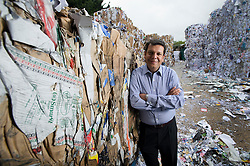Potters Bar, UK. 07/07/2011. Pankaj Chowdhary, Director of Reliance Fibres Ltd pictured at Chas Storer Ltd paper recycling plant in Potters Bar, Herts. Photo credit : Ben Cawthra..