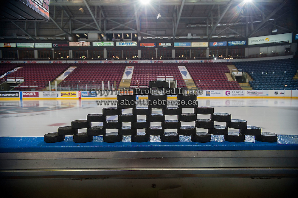 KELOWNA, CANADA - NOVEMBER 21: Warm up pucks are stacked on the Kelowna Rockets' boards before the game against the Portland Winterhawks on November 21, 2014 at Prospera Place in Kelowna, British Columbia, Canada.  (Photo by Marissa Baecker/Shoot the Breeze)  *** Local Caption *** pucks;