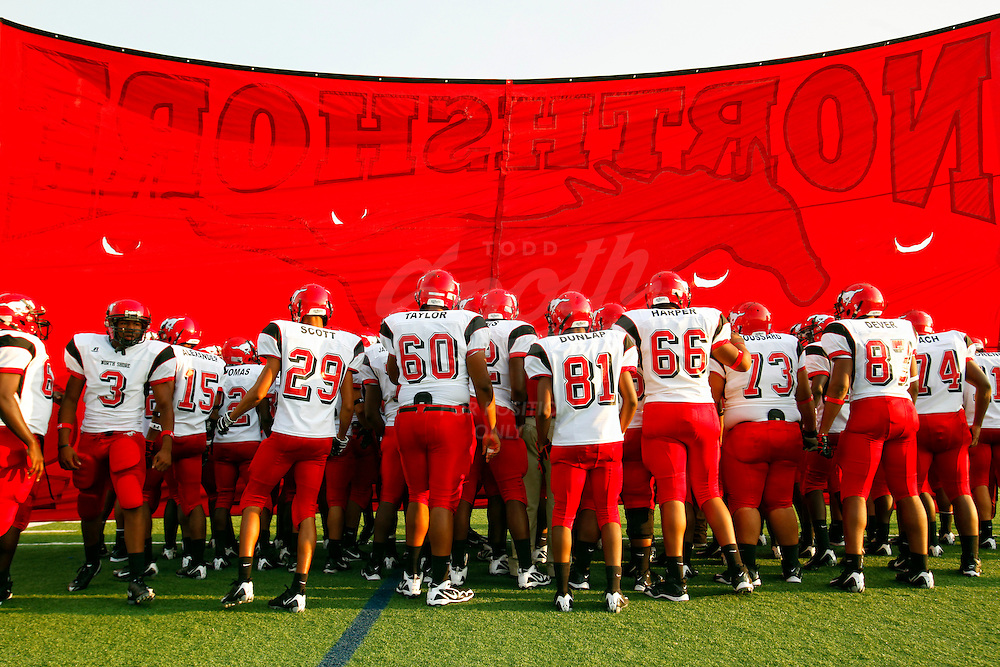 The North Shore Mustangs enter the field prior to the week 0 matchup between the North Shore High School Mustangs and the Katy High School Tigers at Rhodes Stadium in Katy, Texas. The Tigers won the game 7-9. (Todd Spoth/HCN)