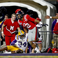 November 17, 2012; Baton Rouge, LA, USA;  Ole Miss Rebels wide receiver Donte Moncrief (12) catches a touchdown over LSU Tigers cornerback Tharold Simon (24) during the second half of a game at Tiger Stadium. LSU defeated Ole Miss 41-35. Mandatory Credit: Derick E. Hingle-US PRESSWIRE