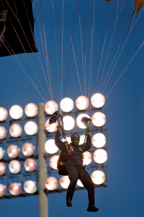 Photo by Kevin Riddell.A member of the Army's Golden Knights parachute team lands in Peden Stadium before the game against Kent State on Saturday, September 29, 2007.