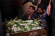 Egyptian Coptic Christian men mourn a victim of sectarian violence October 10, 20011 at the Coptic Hospital in Cairo, Egypt. At least 26 people, mostly Christian, were killed during sectarian clashes that saw the worst violence since the Revolution that toppled former Egyptian president Hosni Mubarak earlier this year. Egyptian Coptic Christians make up about 10% of Egypt's 80 million population and periodically violence flares between the Christian minority and the majority Muslim population. (Photo by Scott Nelson