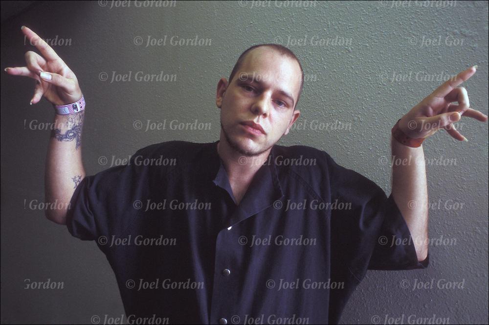 "Gang hand signals, Eastside 8th Street, G.D. ""Gangster Disciple"" Folk Nation, Inmate, gang member making"