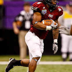 December 18, 2010; New Orleans, LA, USA; Troy Trojans running back Chris Anderson (4) runs against the Ohio Bobcats during the 2010 New Orleans Bowl at the Louisiana Superdome. Troy defeated Ohio 48-21. Mandatory Credit: Derick E. Hingle