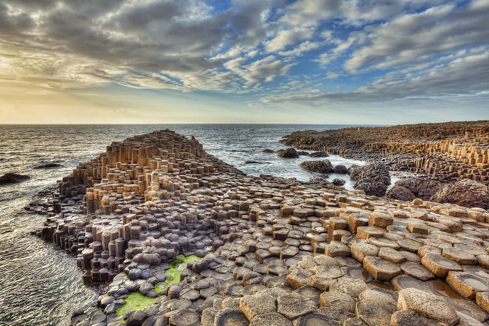 The Giant's Causeway is an area of about 40,000 interlocking basalt columns, a volcanic rock formation that is the result of an ancient volcanic eruption. It is located in County Antrim on the northeast coast of Northern Ireland and it was declared a World Heritage Site by UNESCO in 1986. Most of the columns are hexagonal, although there are also some with four, five, seven or eight sides.
