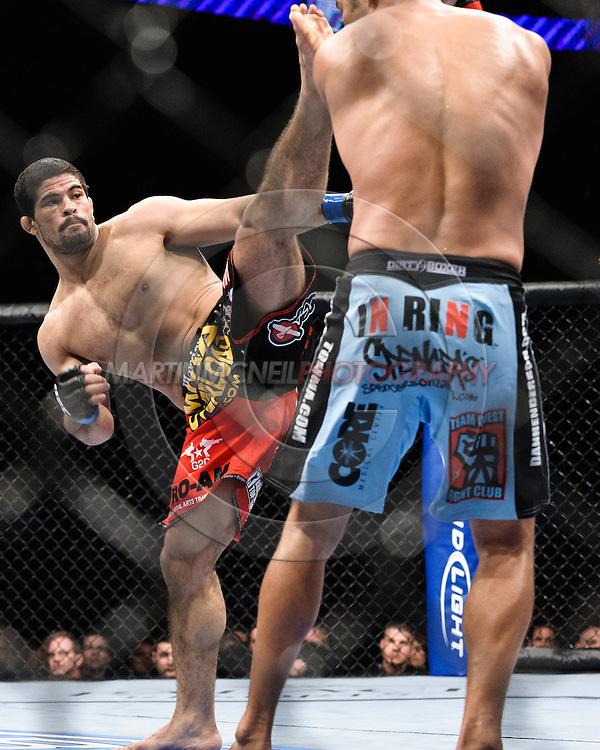 """ATLANTA, GEORGIA, SEPTEMBER 6, 2008: Rousimar Palhares (left) kicks towards the head of Dan Henderson during """"UFC 88: Breakthrough"""" inside Philips Arena in Atlanta, Georgia on September 6, 2008"""