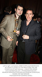 Left to right, comedians JIMMY CARR and ROB BRYDON at a party in London on 17th March 2004.PSN 248