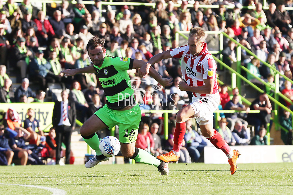 Gavin Gunning and Luke Varney during the EFL Sky Bet League 2 match between Forest Green Rovers and Cheltenham Town at the New Lawn, Forest Green, United Kingdom on 20 October 2018.