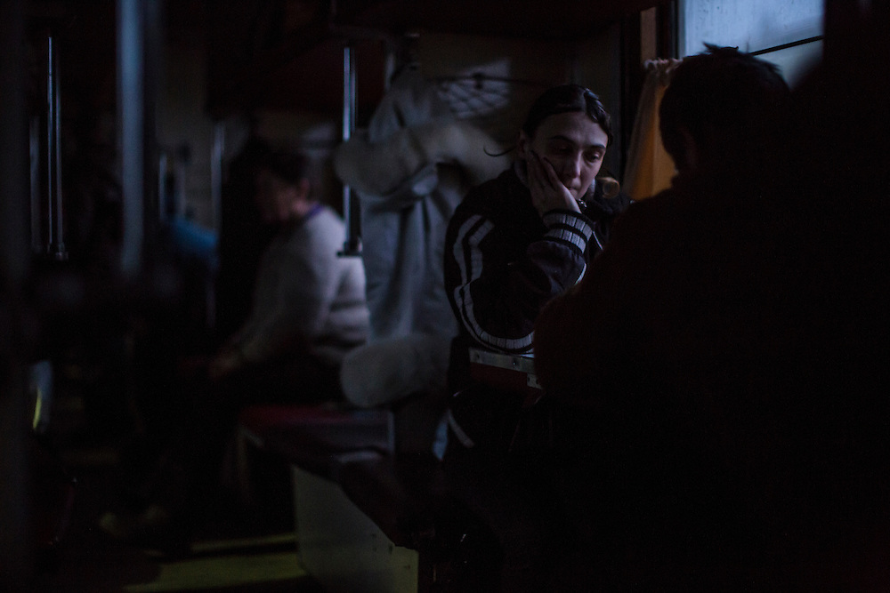 SLOVYANSK, UKRAINE - FEBRUARY 7, 2015: People displaced by fighting in the town of Debaltseve are housed temporarily inside a train in Slovyansk, Ukraine. Many civilians have been evacuated from Debaltseve and brought to Slovyansk, where they are either given a free onward ticket or housed in the train or another facility until they can make further plans. CREDIT: Brendan Hoffman for The New York Times