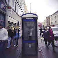 Telephone booth with nightclub flyers on Donegal Place shopping area in Belfast Northern Ireland