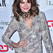 Lizzie Cundy arrive at Float Like A Butterfly Ball for Caudwell Children Charity at Grosvenor House Hotel on 16 November 2019, London, UK.