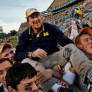 (01/01/08)  Lloyd Carr head coach, University of Michigan is carried off the field after beating the University of Florida at the Capitol One Bowl game at the Florida Citrus Bowl in Orlando on New Years day.