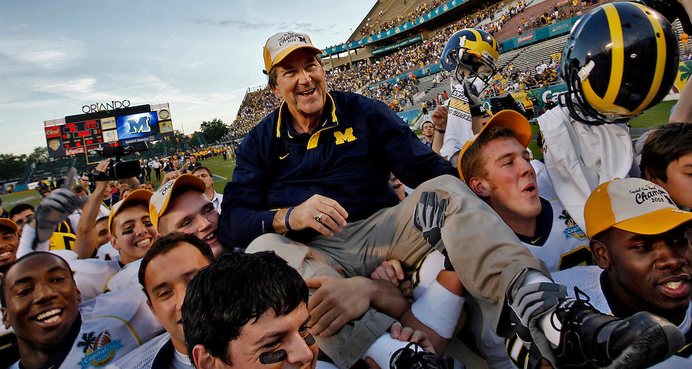 (01/01/08)  Lloyd Carr head coach, University of Michigan is carried off the field after beating the University of Florida at the Capitol One Bowl game at the Florida Citrus Bowl in Orlando on New Years day. (Willie J. Allen Jr.)