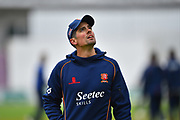 Alastair Cook of Essex looks up to the overcast sky as spot of light rain falls during the warm up before the 2019 media day at Somerset County Cricket Club at the Cooper Associates County Ground, Taunton, United Kingdom on 2 April 2019.
